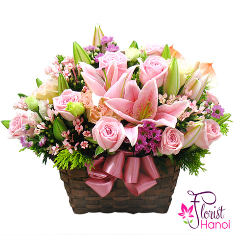 Pink roses and lilies arrangement