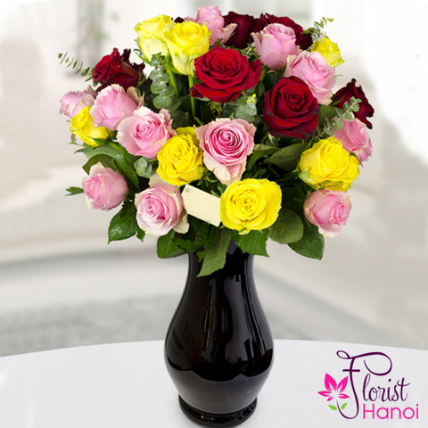 Multi-colored roses in vase