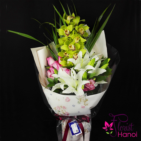 Flower bouquet with orchid and lilies