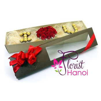 Red roses and chocolate in box for Valentines day
