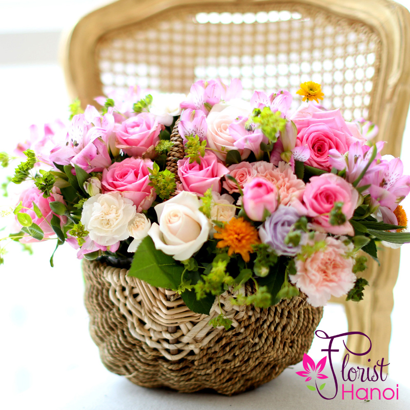Hopeful pink basket arrangement flowers